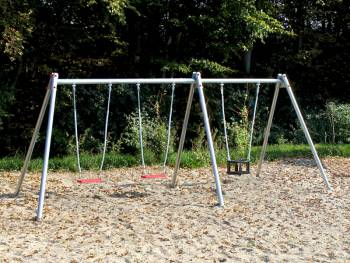 Triple swing on the playground