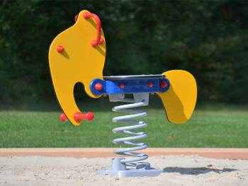 Feather Rocker yellow elephant on the playground