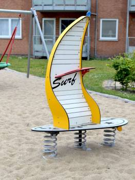 Spring seesaw Windsurfer yellow on the playground