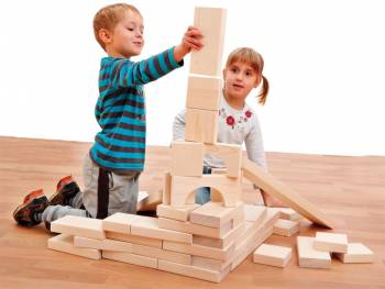 Large wooden blocks natural wit happy playing kids
