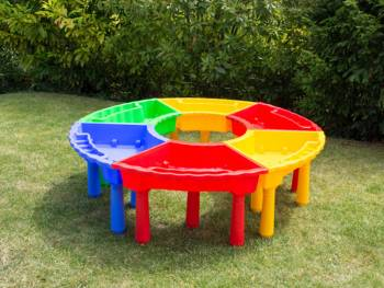 Sand and water play table, mat table trapezoidal in 4 colors open in the garden