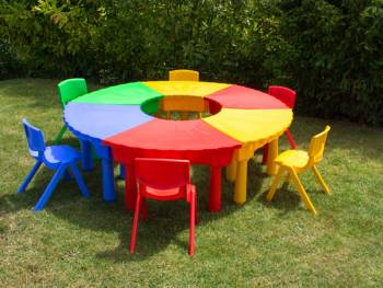 Sand and water play table, mat table trapezoidal in 4 colors closed with chairs on kindergarten playground