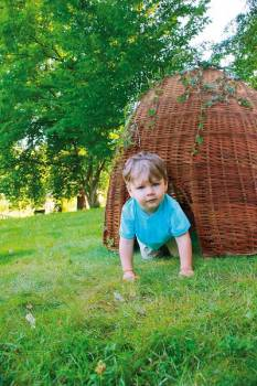 willow hut in the garden with child