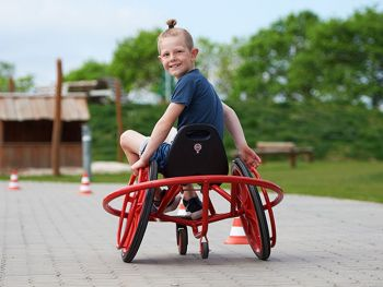 winther wheely rider with happy playing child