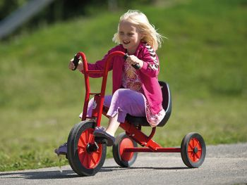 Winther tricycle maxi with happy kid on the playground