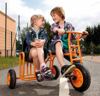 Kindergarten tricycle sidecar wth happy playing children