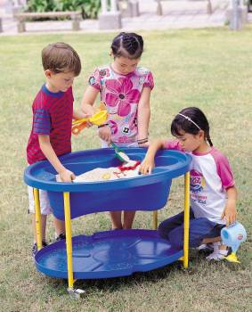 Sand and water play table, blue with happy playing children
