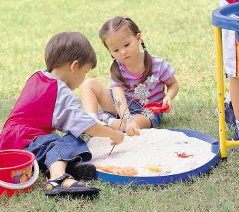 Sand and water play table with children