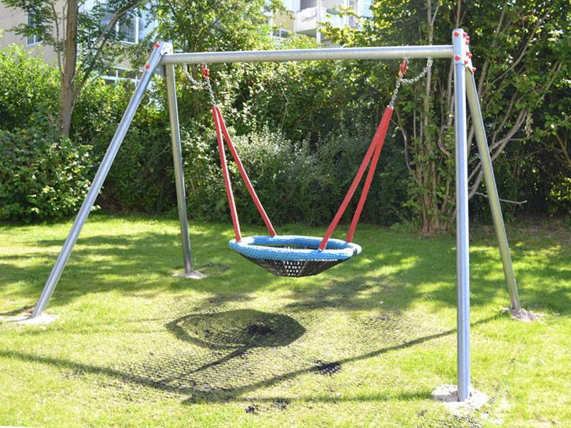 birds-nest-swing-120-complete on the playground with rubber safety plates on lawn