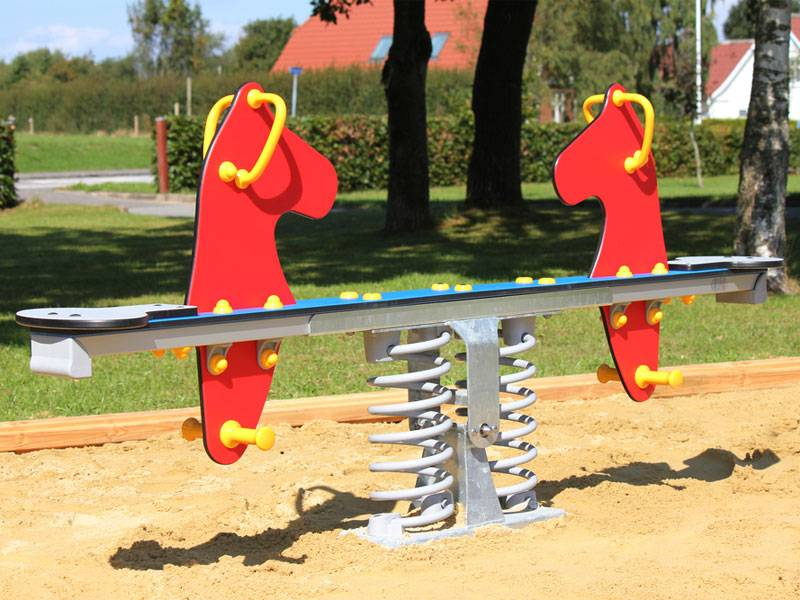 Spring seesaw red seahorse on the playground
