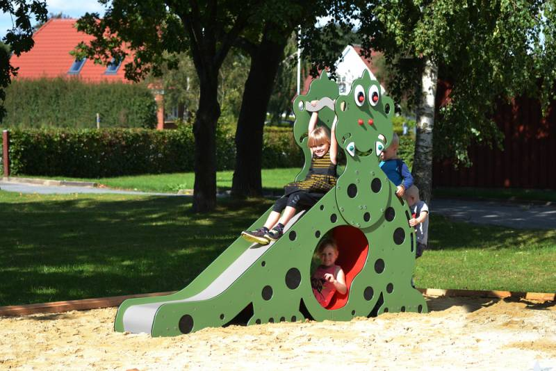 Dino slide with playing children