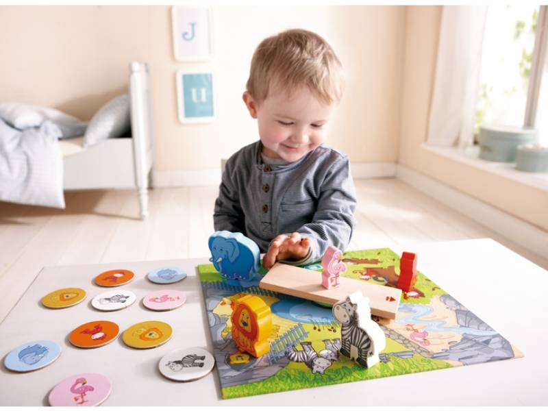 Motorics game Animal Carousel from Haba with happy playing boy