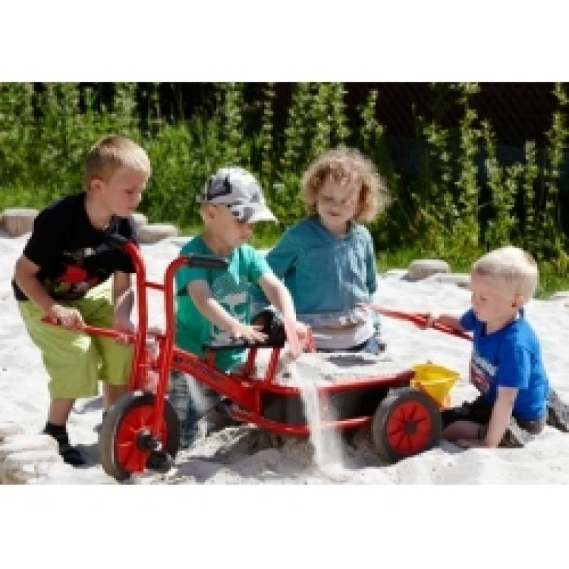 winther truck trycycle in the sanbox with happy playing chldren
