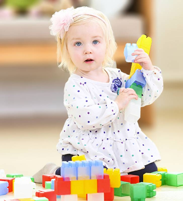 kids-blocks-soft building blocks with happy playing girl