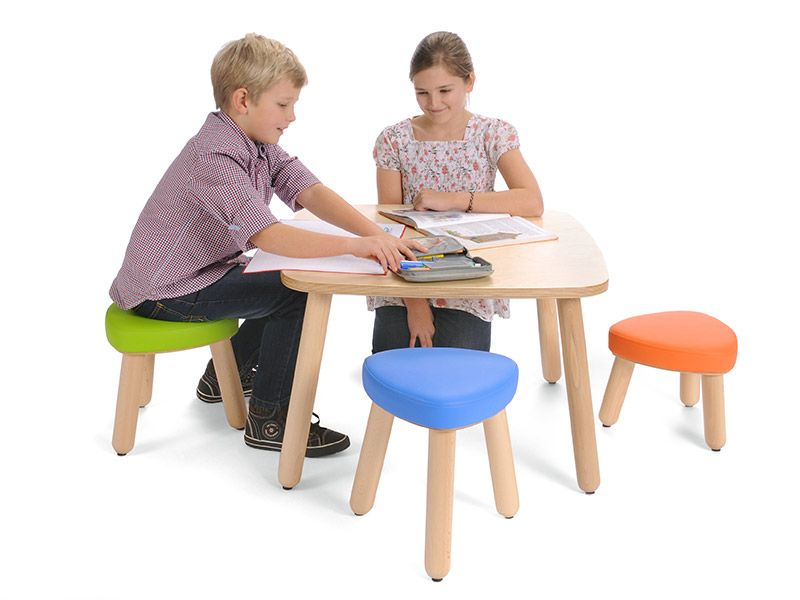 Upholstered stool Trinitas in 3 different seat heights with happy children playing on the table
