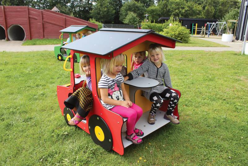 Playmobile tractor in red with children on kindergarten playground