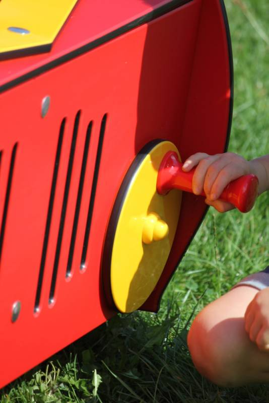 Playmobile tractor in red moving game spotlight with child in action