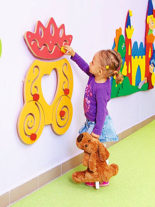 Wall play royal carriage with happy playing little girl